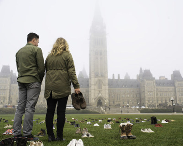 Adam Garone and Sue Johnson Place Shoes on Parliament Hill (CNW Group/Movember Canada)