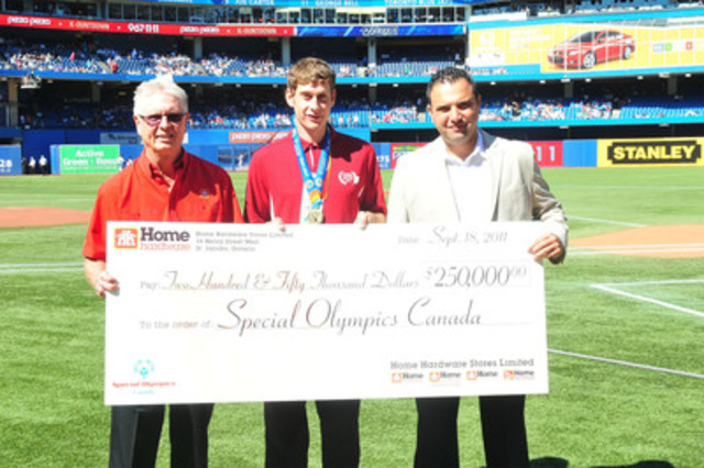 John Locke, (Left) Dealer-Owner of Orillia Home Hardware Building Centre, marked Home Hardware Blue Jays Fan Appreciation Day by presenting a $250,000 cheque to Austin Featherstone, (Middle) a Special Olympics Canada Athlete and Anthony Miceli, (Right) Vice-President Business Development and Marketing from Special Olympics Canada during an infield ceremony at the Rogers Centre. (CNW Group/Home Hardware Stores Limited)