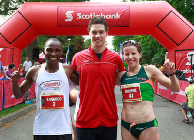 Winners of the Scotiabank Vancouver Half-Marathon Kip Kangogo (left) from Lethbridge Alberta and Krista Duchene (right) from Brantford Ontario celebrate with Mason Raymond, Honourary Chair of the Scotiabank Charity Challenge, Sunday, June 23, 2013. The event raised $725,000 for 71 participating charities through the Scotiabank Charity Challenge. (CNW Group/Scotiabank - Sponsorships & Donations)