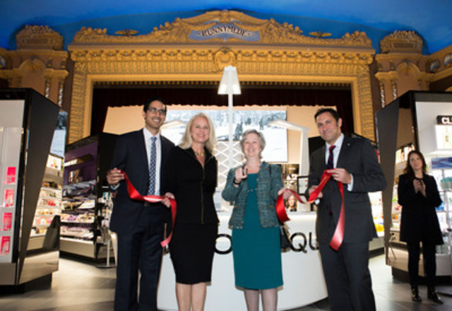 (Left to Right) Manjit Singh Hansra, Pharmacist-owner, Cathy Masson, VP Category Management, Toronto City Councillor Sarah Doucette and Anthony Spina, VP Operations Ontario cut the ribbon to open the new Enhanced beautyBOUTIQUE in the iconic Runnymede Theatre heritage building in Bloor West Village Toronto, ON, April 21, 2015.  (Photographer: John Packman) (CNW Group/Shoppers Drug Mart Corporation)