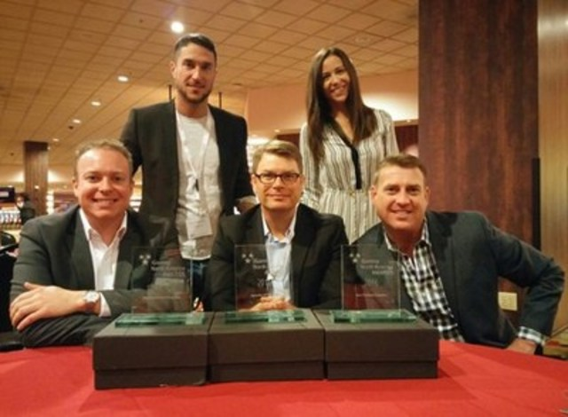 NYX Wins Best Platform Supplier at iGNA Awards (Front row: Lee Terfloth, Director, Interactive Product for ...