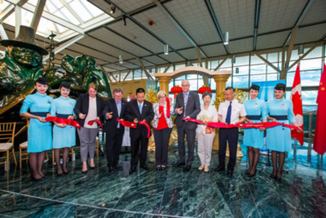 Xiamen Airlines Ribbon Cutting (from Left): Xiamen Airlines Cabin Crew; Dayna Miller, Director of Sales, Leisure Travel, Tourism Vancouver; Mr. Ben Stewart, British Columbia Special Representative in Asia; Mr. Shanglun Che, Chairman & President, Xiamen Airlines; Honourable Carla Qualtrough, Minister of Sport and Persons with Disabilities; Craig Richmond, President & CEO, Vancouver Airport Authority; Ms Liu Fei, Consul General of People's Republic of China; Mr. Weidong Zhou, Vice President, Xiamen Airlines; Xiamen Airlines Cabin Crew (CNW Group/Vancouver Airport Authority)