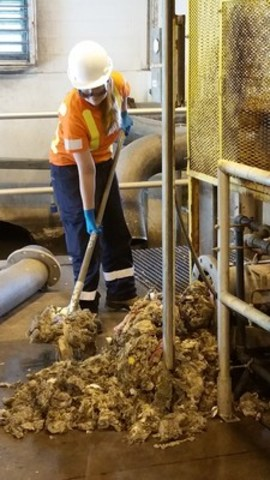 An Ontario Clean Water Agency Wastewater Operator cleans up non-flushable debris, showcasing why the I Don't Flush 2016 public awareness campaign - encouraging the public to take a closer look at their personal hygiene disposal habits - is necessary. www.idontflush.ca. (CNW Group/Ontario Clean Water Agency)