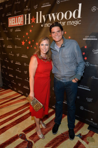 Hello TIFF Sept 8, 2012 LtoR: Lisa Tant, Milos Raonic. HELLO! Canada welcomed a cast of celebrities and VIP guests to the Ritz-Carlton Toronto Saturday night for its annual Toronto Film Festival gala. Here HELLO! Canada Publisher Lisa Tant welcomes Canadian tennis star Milos Raonic. (CNW Group/HELLO!)