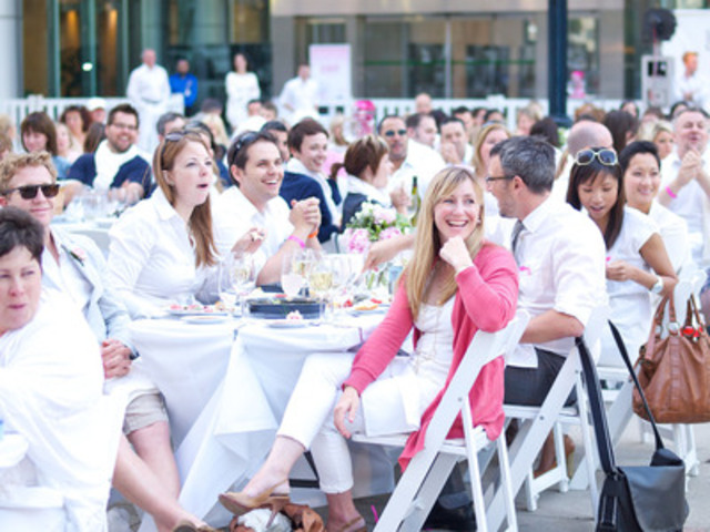 Spontaneity on the menu - Dinner guests make a dramatic splash in pink and white as part of the first-ever Cook for the Cure PINKnic, presented by KitchenAid. Participants weren't told the exact location of the event - David Pecaut Square in Toronto's theatre district - until two hours before it began. This flash mob dinner raised funds and awareness for the Canadian Breast Cancer Foundation. (CNW Group/KitchenAid Canada)