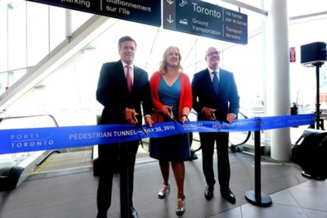 The Honourable Lisa Raitt, Minister of Transport, and His Worship John Tory, Mayor of Toronto, join Mark McQueen, Chairman of PortsToronto, in cutting the ribbon to celebrate the opening of Billy Bishop Toronto City Airport's pedestrian tunnel. (CNW Group/PortsToronto)