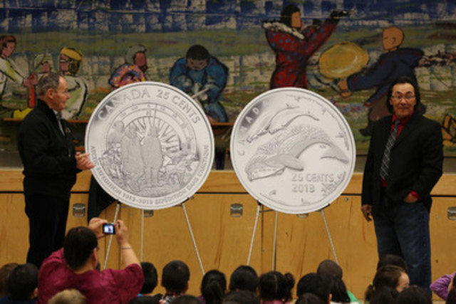 Royal Canadian Mint Board of Directors member Claude Bennett and Cape Dorset NU artist Tim Pitsiulak unveil new 25-cent circulation coins celebrating the 100th anniversary of the Canadian Arctic Expedition and Life in the North at Mullin Illihakvik Elementary school in Cambridge Bay, NU (CNW Group/Royal Canadian Mint)