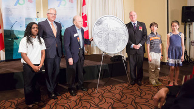 Carman Joynt, Director from the Royal Canadian Mint Board of Directors, Veteran Alex Polowin, Erin O'?Toole, Parliamentary Secretary to the Minister of International Trade and students unveil the silver coin to commemorate the 70th anniversary of D-Day. The unveiling took place in Ottawa at a special send-off for Canadian Second World War veterans who will attend D-Day memorial events in Normandy, France. (CNW Group/Royal Canadian Mint)