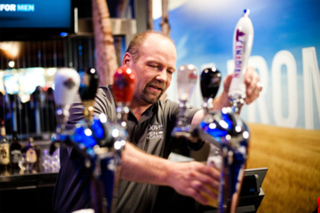 Hockey legend Wendel Clark served 68 beers at last night's Maple Leafs game during first of three Dove Men+Care® Real Man Challenges (CNW Group/Dove)