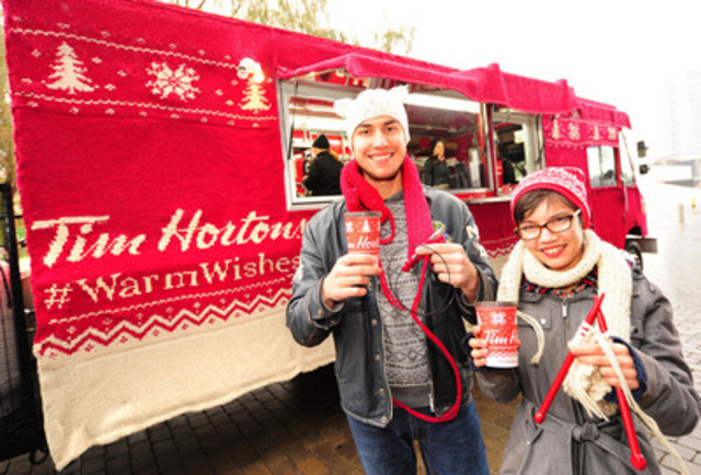 "To celebrate the launch of Tim Hortons new #WarmWishes holiday cups and social media campaign to encourage Canadians to share good deeds over the holiday season, Tim Hortons, with the help of Toronto-based knitting store, Lettuce Knit, ""yarn-bombed"" Tim Hortons' mobile coffee truck in the same sweater motif as its holiday cups. (CNW Group/Tim Hortons)"