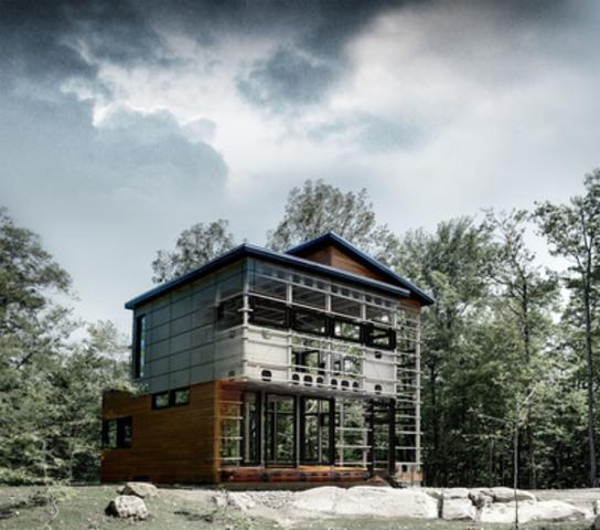 Maison à structure d'acier BONE Structure, lauréate du prix INNOVATION 2011 décerné par l'Association de la Construction du Québec à M. Jean-Marc Boudreau, concessionnaire autorisé BONE Structure. (Groupe CNW/BONE STRUCTURE)