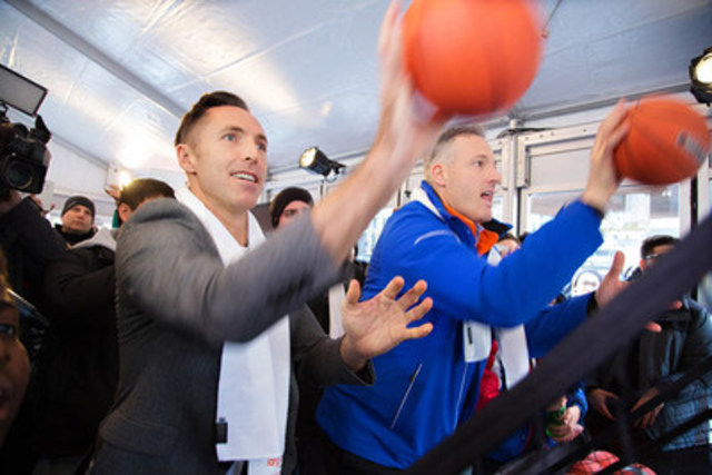 7-time NBA All-Star, Steve Nash, and Tangerine President and CEO, Peter Aceto, competed in a basketball pop-a-shot game at the launch of the Steve Nash Assist program today at Yonge and Dundas Square in Toronto. (CNW Group/Tangerine)