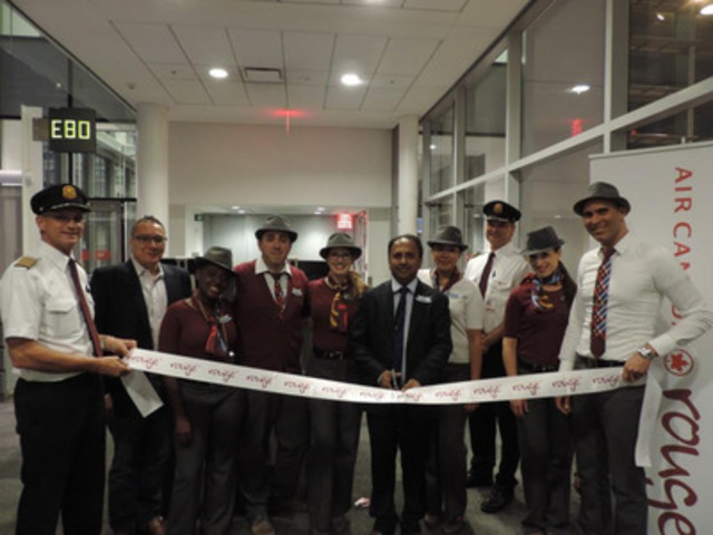Air Canada rouge Lisbon 1 - Air Canada rouge pilots, rouge crew, William Delgado (second from left - Country Manager for the Portuguese National Tourist Office) and Vijay Bathija (center - Vice President of Commercial for Air Canada rouge) commemorate the first flight from Toronto to Lisbon on 21 June 2014 (CNW Group/Air Canada rouge)