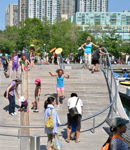 Two km of fun for everyone. Music, dancers, buskers, shopping, food and beverage delights, stunt dogs, paddle boarding, all along Queens Quay, June 19-21 at the Redpath Waterfront Festival. Free admission. Photo courtesy of Light Monkey Photography (CNW Group/Redpath Waterfront Festival)