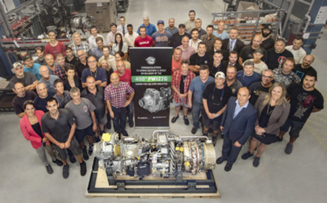 Pratt & Whitney Canada team members stand with the 400th PW127G engine to be delivered to Airbus Defence and Space for the C295 Airlifter. (CNW Group/Airbus Defence and Space)