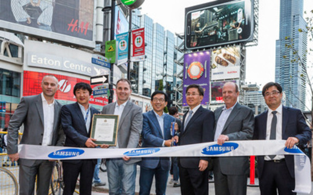 Samsung Canada and special guests gathered today in Toronto's Yonge-Dundas Square during the NXNE Festival to celebrate their launch of Canada's biggest outdoor LED billboard. (Pictured from L to R: Mark Childs, CMO, Samsung Canada; Michael Park, CFO, Samsung Canada; Josh Colle, Councillor Ward 15, City of Toronto; HT Kim, President & CEO, Samsung Canada; Chung Kwang-kyun, Consul General, Republic of Korea; John Jory, President, Clear Channel; Kim Byung-jun, Consul, Republic of Korea) (CNW Group/Samsung Electronics Canada Inc.)