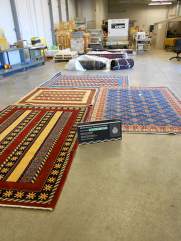 Four area carpets that concealed heroin (CNW Group/Royal Canadian Mounted Police)