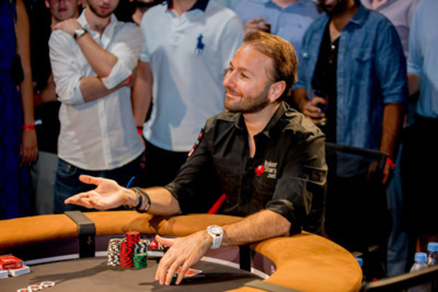 Canadian poker legend Daniel Negreanu entertains fans during a charity poker tournament at Real Sports Bar & Grill in Toronto. Negreanu went on to win the tournament and $20,000 for Right To Play. (CNW Group/PokerStars.net)