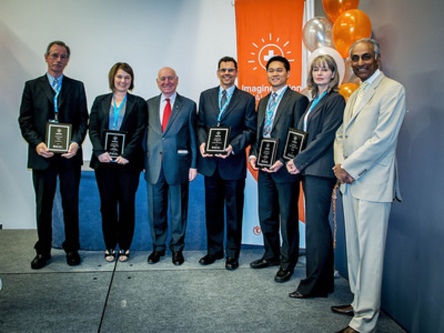 First place award recipients in Canada Health Infoway's ImagineNation Outcomes Challenge accept their awards in Ottawa on May 27, 2013. From left to right, Geoff Spooner representing a team of 14 British Columbia clinics, Deana Leicht of Sunnybrook Health Sciences Centre, Canada Health Infoway Chairman of the Board Graham W.S. Scott, Dr. Peter Rossos of the University Health Network, Andrew Liu of Toronto East General Hospital, Krystyna Hommen of Excelleris Technologies, and Canada Health Infoway President and CEO Richard Alvarez. (CNW Group/Canada Health Infoway)