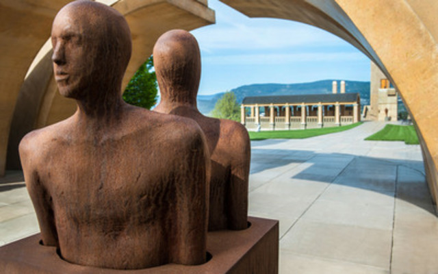 """Matching figures encased in corten steel - a  dramatic first impression for visitors entering Mission Hill Family Estate through the winery's Keystone entry, itself a work of art, a 20 ton block of Indiana limestone carved by a master Welsh stonemason. Sculpture Name: """"Movement"""" (CNW Group/Mission Hill Family Estate)"""