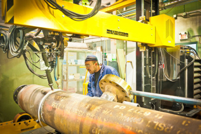 Compass Vessels Facility - Compass Compression employee Elvis Cendach working on a pressure vessel using a sub arc welder. (CNW Group/Compass Compression Services Ltd.)