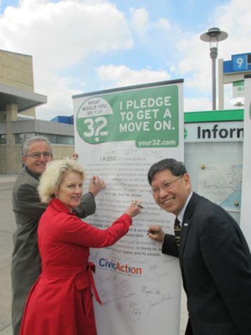 "Vaughan Councillor Alan Shefman, Markham Councillor Valerie Burke, and Richmond Hill Councillor Godwin Chan sign CivicAction's ""Pledge to Get a Move On"" (CNW Group/CivicAction)"
