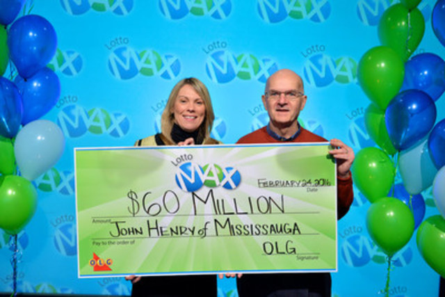OLG's Vice President of Lottery Marketing and Sales Wendy Montgomery presents Mississauga resident John Henry with a cheque for $60,000,000 at the OLG Prize Centre Wednesday. John won the December 25, 2015 LOTTO MAX jackpot. (CNW Group/OLG Winners)