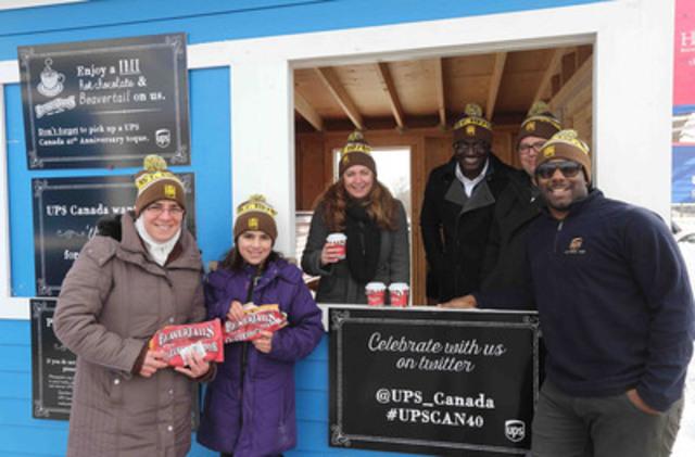 UPS Canada a célébré son 40e anniversaire le dimanche 1er mars dernier à Halifax, à la patinoire Emera. Lubna Channaa, employée d'UPS, Aya Alkhairi, une invitée d'UPS, ainsi que Shannon Wetmore, Kafui Atoklo, Tim Mason et Jason Belgrave, tous des employés d'UPS, ont distribué du chocolat chaud,  des queues de castor et des tuques commémoratives pour souligner l'événement et dire « merci » aux employés et à la collectivité. (Groupe CNW/UPS Canada Ltee.)