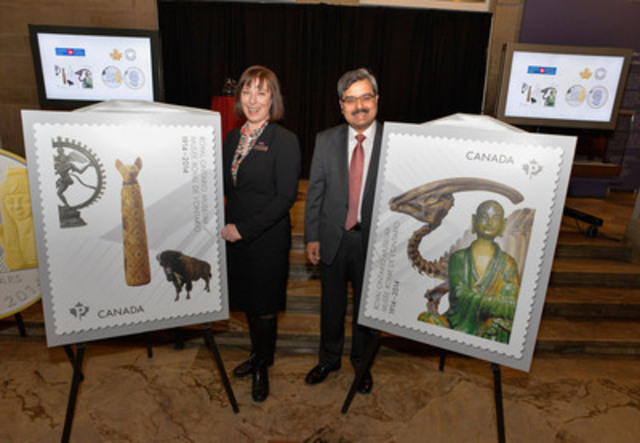Canada Post President and CEO Deepak Chopra and Royal Ontario Museum Director and CEO Janet Carding unveil two new commemorative stamps featuring images of iconic objects from the Museum's world-renowned collection. (CNW Group/Canada Post)