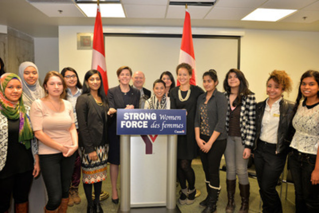 "The Status of Women Canada, Plan Canada, YWCA Canada and YMCA Canada launched ""Strong Girls, Strong World,"" a new national program for young women leaders on International Women's Day on March 8, 2015. Pictured here with girls from the Greater Toronto Area are the Hon. Kellie Leitch, Minister of Labour and Minister of Status of Women (centre left), Scott Haldane, CEO of YMCA Canada (centre), Chantelle Krish, Manager of Advocacy and Public Relations of YWCA Metro Vancouver (fifth from left), and Kristy Payne, Plan Canada's Vice President of Communications and Public Engagement (fifth from right). Photo: Shan Qiao (CNW Group/Plan Canada)"