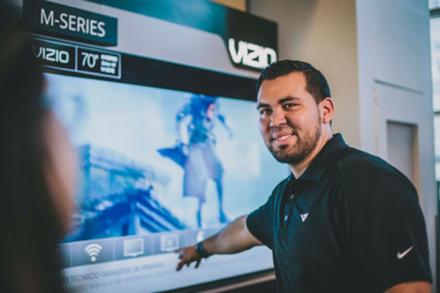 A customer is dazzled by the new VIZIO Smart TV and audio display at Future Shop's flagship store in downtown Toronto. VIZIO's award-winning Smart TVs and audio products are now available at every Future Shop in Canada and online at Futureshop.ca. (CNW Group/Future Shop)