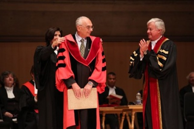Professor David N. Weisstub (centre), received an Honorary Doctor of Laws degree (LLD) on September 23 at the Call to the Bar ceremony in Toronto. Here, he receives the LLD hood from Law Society Lay Bencher Catherine Strosberg, while Law Society Treasurer Paul Schabas (right) congratulates him. An international, distinguished leader in forensic psychiatry and human rights, Prof. Weisstub received the LLD in recognition of his work as a pioneer in the development of law and mental health. (CNW Group/The Law Society of Upper Canada)