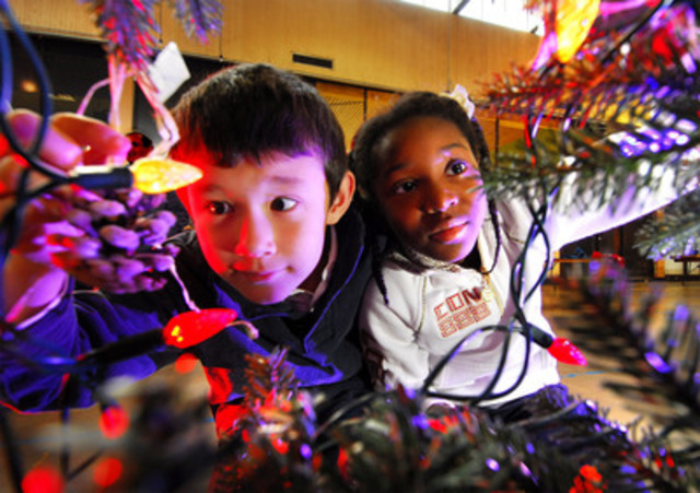 Students Tanneguy (left) and Chante of St. Michael Catholic School greening the holidays one LED at a time. (CNW Group/Toronto Hydro Corporation)