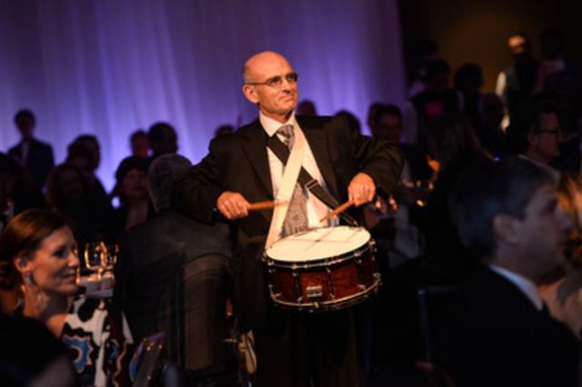 Toronto Symphony Orchestra (TSO) principal percussionist, John Rudolph, leads members of the orchestra in a surprise musical interlude during the exclusive gala, celebrating the launch of the 2015/2016 TSO season on Thursday, September 24, 2015 at The Ritz-Carlton, Toronto. (Photo credit: Paul Alexander) (CNW Group/Toronto Symphony Orchestra (TSO))