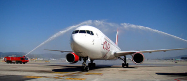 Air Canada rouge Montreal Barcelona 2 - water cannon salute to welcome the first Air Canada rouge flight from ...