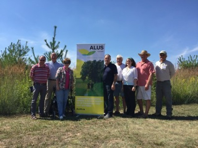 ALUS Canada relaunches in Waterford, Ontario, where ALUS has established acres of native plants, trees and shrubs. From R to L: Jeff Helsdon (representing MPP Toby Barrett), Bryan Gilvesy (ALUS Canada Executive Director), MP Diane Finley, Norfolk Mayor Charlie Luke, Dave Reid (ALUS Canada Eastern Hub Manager), Casey Whitelock (ALUS Norfolk coordinator), Tracey Boerkamp (Springview Farm), Chris Van Paassen (ALUS Norfolk Chair). (CNW Group/ALUS Canada)