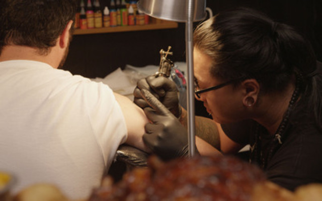 Montana's releases the world's first ad campaign paid for in meat. A great deal for everyone. Trading Montana's Cookhouse BBQ for a real tattoo. (CNW Group/Montana's Cookhouse & Bar)