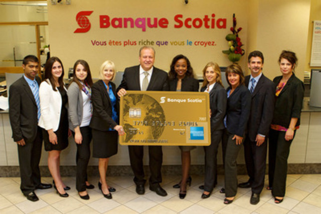Just landed! Scotiabank employees at the Rene Levesque & University branch in Montreal, Quebec celebrate the arrival of the new Scotiabank American Express® Cards - a suite of loyalty cards designed for travel enthusiasts. (CNW Group/Scotiabank - Products & Services)