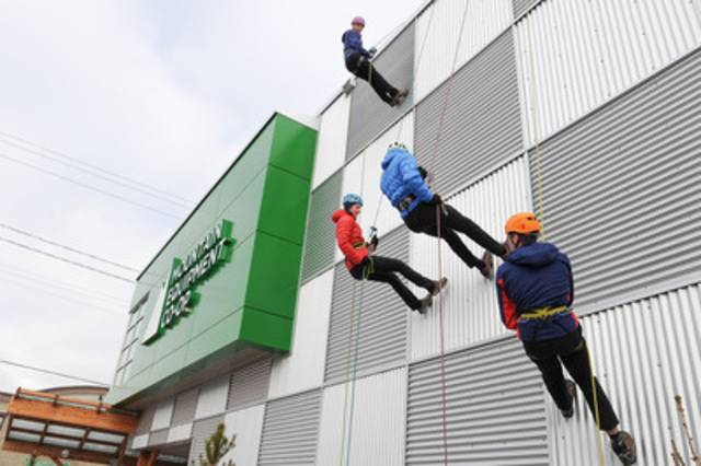 Climbing experts from Mountain Equipment Co-op rappel down the expanded Ottawa store before throwing the doors open for a special store preview. Mountain Equipment Co-op will be celebrating with the public on Saturday, December 1 with food, clinics and prizing. (CNW Group/MOUNTAIN EQUIPMENT CO-OP)