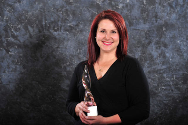 Ashley Therriault from Veritas Communications accepts the gold Award of Excellence in marketing communications (CNW Group/Canadian Public Relations Society)