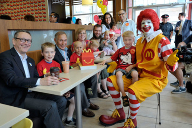 McDonald's Canada President and CEO John Betts, left, McDonald's Canada Founder George Cohon, 3rd left, and families staying at Ronald McDonald House, celebrate the 20th McHappy Day in Toronto, Wednesday, May 8, 2013. The Canadian Press Images PHOTO/McDonald's Restaurants of Canada Limited (CNW Group/McDonald's Restaurants of Canada Limited)