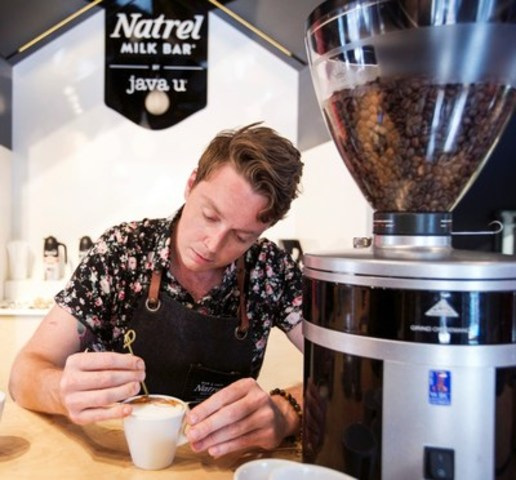 Game of Foams: Internationally renowned coffee artist Michael Breach paints the ''Toronto Latte'' in milk foam, which was unveiled today at the grand opening of the new Natrel Milk Bar by java u in Toronto's trendy West Queen West neighbourhood. (Photo credit: Max Kopanygin) (CNW Group/Natrel)