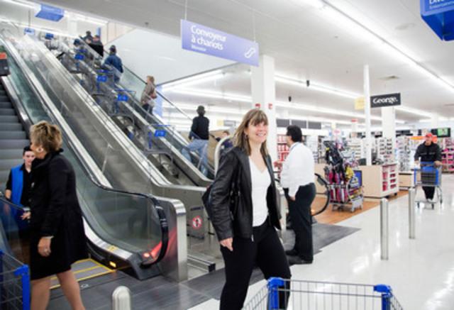 Customer and shopping cart escalator between floors (CNW Group/Walmart Canada)