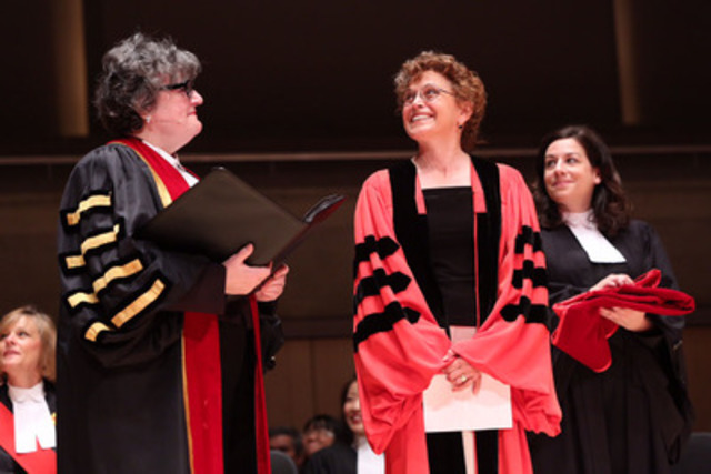 Jean Teillet (centre) was conferred with the Doctor of Laws honoris causa by Law Society Treasurer Janet Minor (left) this morning at the June 26th Call to the Bar ceremony at Roy Thomson Hall. Teillet is pictured here about to receive the ceremonial hood from Bencher Jacqueline Horvat. (CNW Group/The Law Society of Upper Canada)