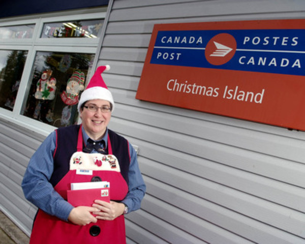 Hughena MacKinnon, Postmistress at the Christmas Island Post Office in Cape Breton, NS, receives thousands of letters from holiday enthusiasts and collectors from around the world in search of the special Christmas Island postmark. (CNW Group/Canada Post)