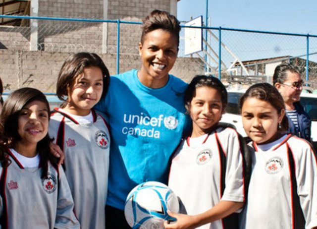 "UNICEF Canada ambassador and Olympic bronze medalist Karina LeBlanc with participants of UNICEF's ""Football for Life"" program in Honduras. The program helps decrease drop-out rates and promotes healthy lifestyles for 40,000 vulnerable children across the country. (CNW Group/UNICEF Canada)"