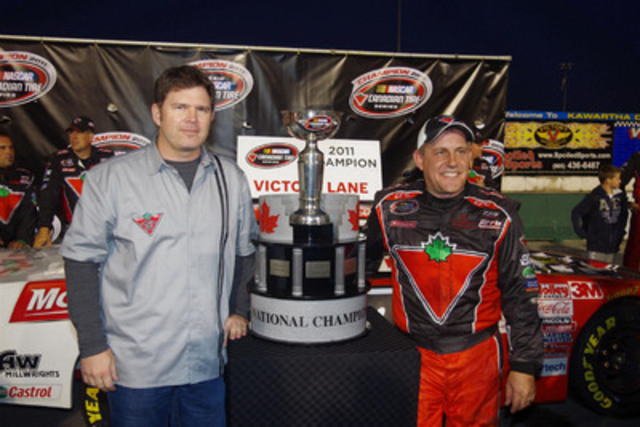 Allan MacDonald (l), Senior VP of Automotive for Canadian Tire stands with NASCAR Canadian Tire Series champion Scott Steckly (r) following the season finale at Kawartha Speedway on Saturday Night. Steckly finished second in the race to secure his second Canadian national stock car championship in the past four years. (CNW Group/Wide Open Motorsport Solutions Inc.)