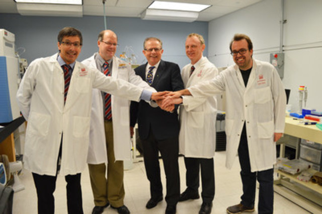 Left-to-right: Dr. Daniel Figeys, University of Ottawa; Dr. David Mack, CHEO Research Institute; Dr. Phillip Sherman, CIHR; Dr. Alain Stintzi, University of Ottawa; Dr. James Butcher, University of Ottawa (CNW Group/Canadian Institutes of Health Research)