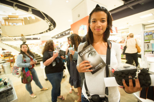 At 12:01am on June 18th, 2015 at Indigo Yonge and Eglinton, Fifty Shades of Grey fan Shaira Mayers waits eagerly to purchase one of the first copies of Grey to be sold in Toronto. The novel is the latest book in EL James' best selling series. (CNW Group/Indigo Books & Music Inc.)