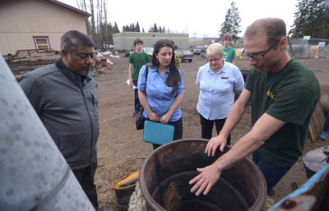 Smithers Secondary School teacher Rick Hubert shows Staples reps Victor Chima, Laura Bernard and Patsy Titcomb a bio-burner he and the students developed. For their environmental initiatives, Smithers Secondary School is receiving $25,000 worth of new technology from Staples Canada. (The Canadian Press Images) (CNW Group/Staples Canada Inc.)